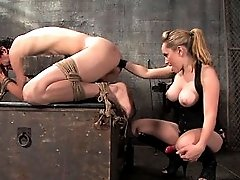 Blonde Dominatrix with gorgeous tits makes slave boy BARK!